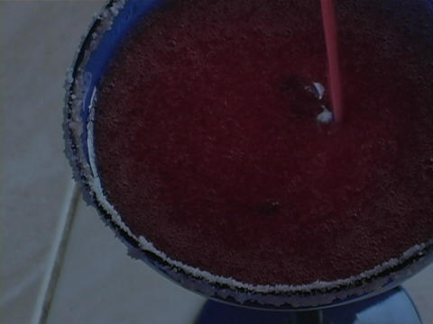 A blended margarita pours into a cobalt glass rimmed with... Stock Video Footage