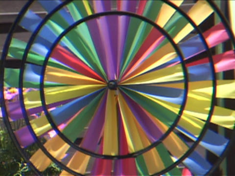 A colorful pinwheel spins Stock Video Footage