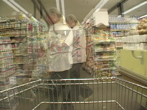 Consumers purchase items in a grocery store Stock Video Footage