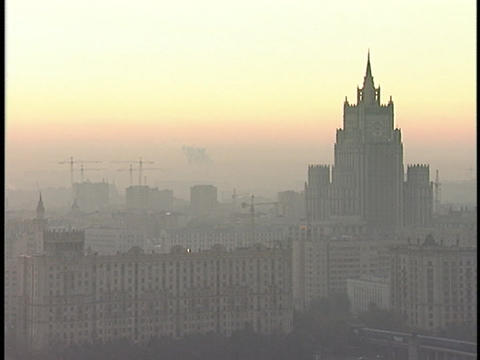 Smog surrounds a skyscraper Stock Video Footage