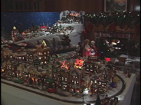 A model train speeds on its tracks around a Christmas... Stock Video Footage
