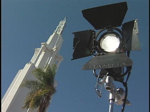An outdoor stage light and white tower stand side by side Footage