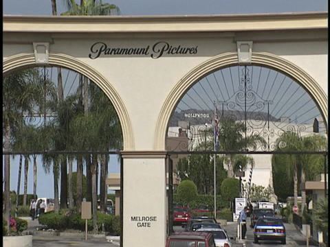 Cars enter and exit the Paramount Pictures gates Stock Video Footage