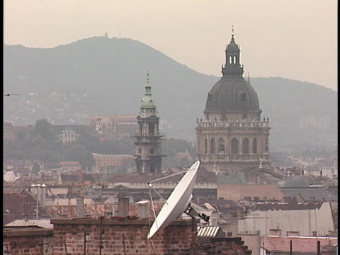 Mountains obscured by smog stand behind a city skyline Stock Video Footage