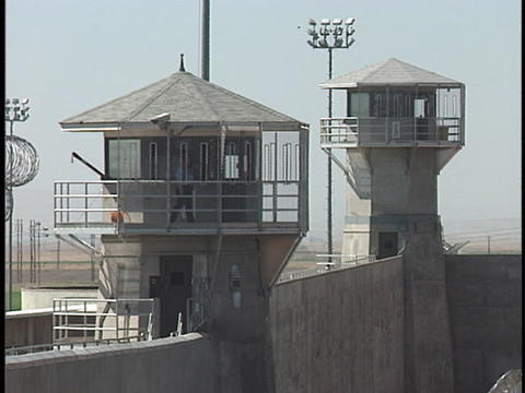 A prison guard walks around the perimeter of his watch... Stock Video Footage