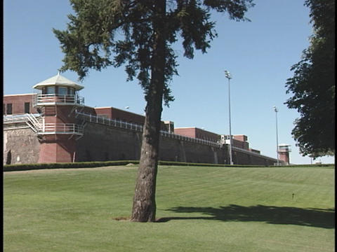 A Wall And Guard Tower Surround A Correctional Facility stock footage