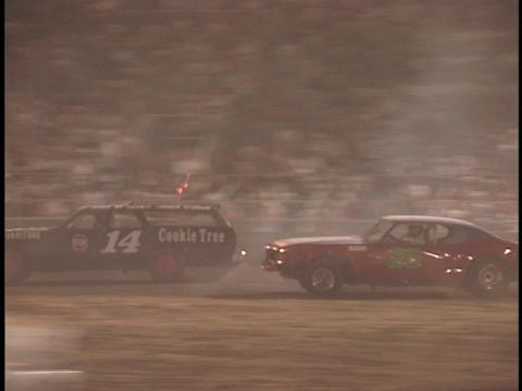 demolition cars smash into each other as they race around... Stock Video Footage