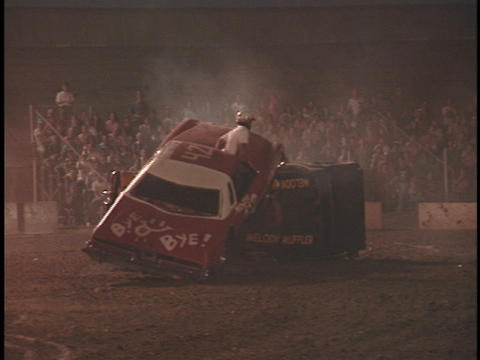 A fire truck enters the arena at a demolition derby Footage