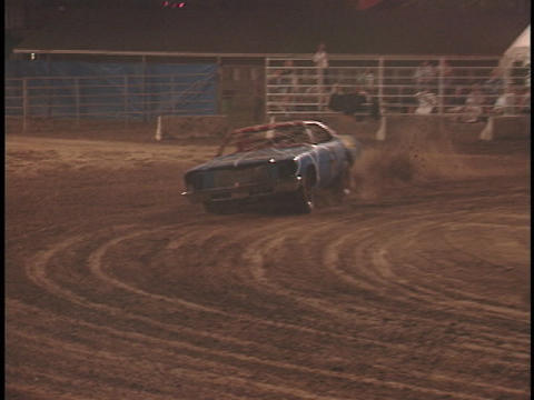 Cars smash into each other during a demolition-derby Stock Video Footage