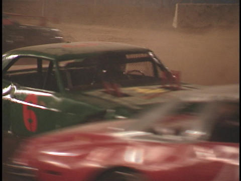 Cars smash into each other during a demolition-derby Footage
