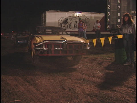 Competitors in a demolition derby drive their cars into... Stock Video Footage