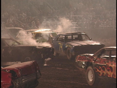 Demolition cars repeatedly crash into one another Stock Video Footage