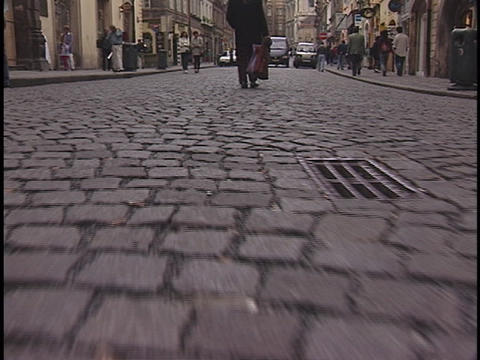 Pedestrians walk on a brick road Stock Video Footage