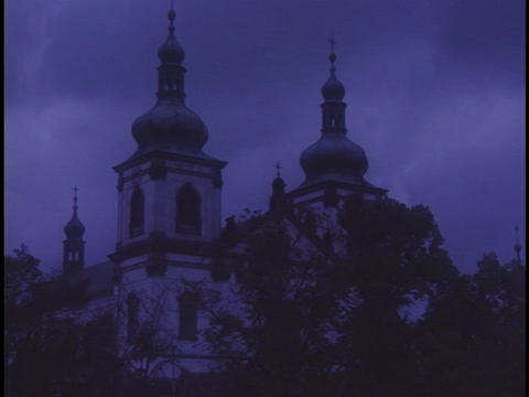 The towers of a church rise into the sky Stock Video Footage