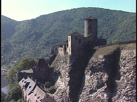 An aerial of a large castle on a mountain top Footage