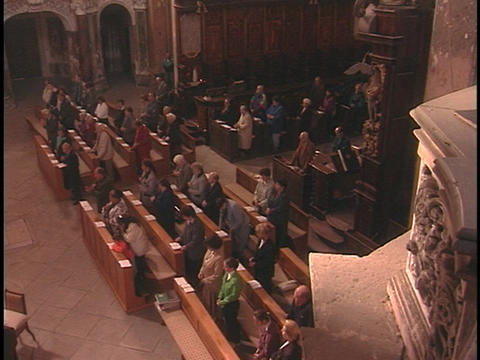 A church congregation prays during services Stock Video Footage