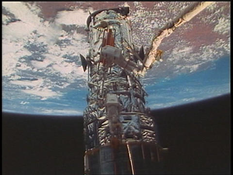 Astronauts fix a satellite during a space walk Footage