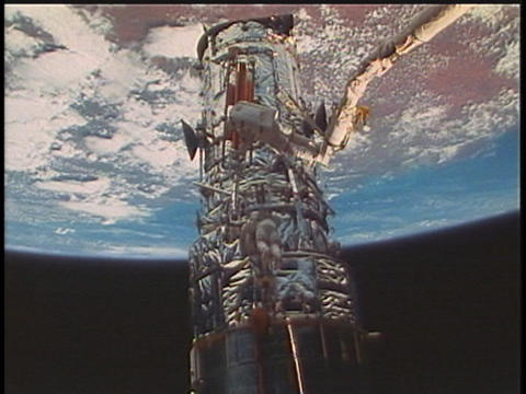 Astronauts fix a satellite during a space walk Stock Video Footage