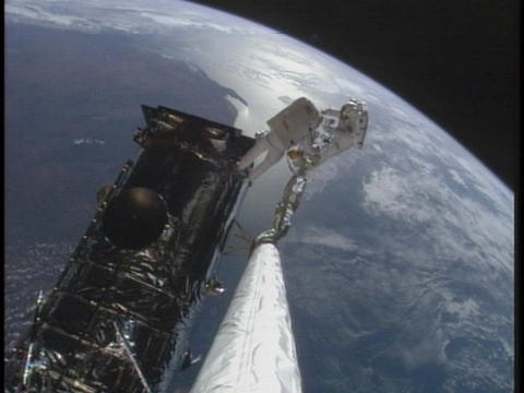 Astronauts work on the International Space Station Footage