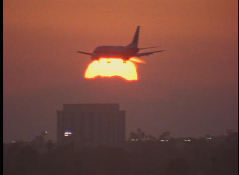 An Airplane Flies Past The Sun stock footage