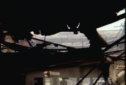 Pan across burned out buildings during the LA riot Footage