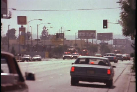 Fire trucks responding during the LA riots in 1992 Stock Video Footage