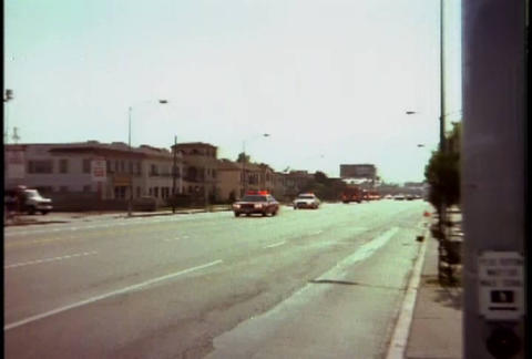 Police and fire trucks respond during the LA riots Stock Video Footage