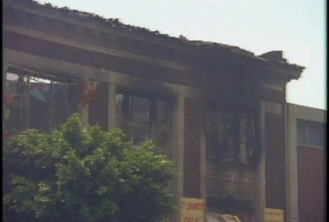 A strip mall is burned during the LA riots in 1992 Footage