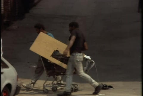 Looters steal things during the LA riots in 1992 Stock Video Footage