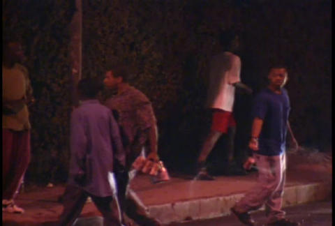 People rioting at night during the LA Riots Footage