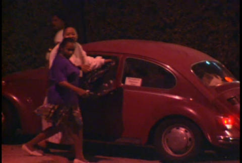 Looters walk the streets at night during the LA Ri Footage