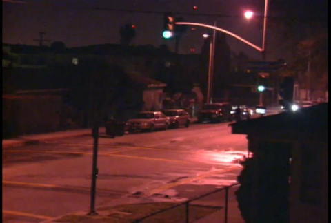 Looters walk the streets at night during the LA Ri Stock Video Footage