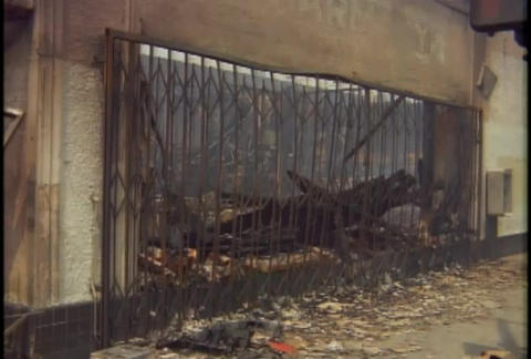Burned out buildings during the LA riots in 1992 Stock Video Footage