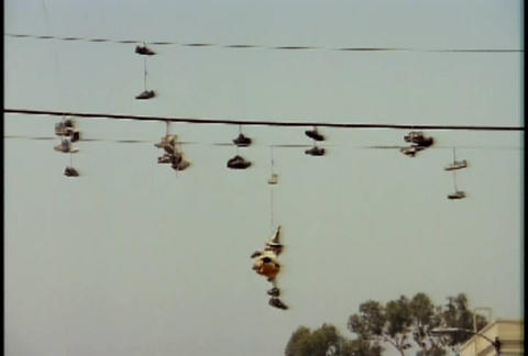Shoes hang on telephone lines during the LA riots Stock Video Footage