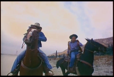 Cowboys Ride Their Horses Fast Across The Desert I stock footage