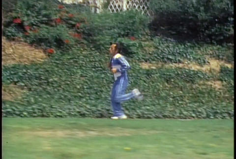 A retro man jogs on a trail through a park Footage
