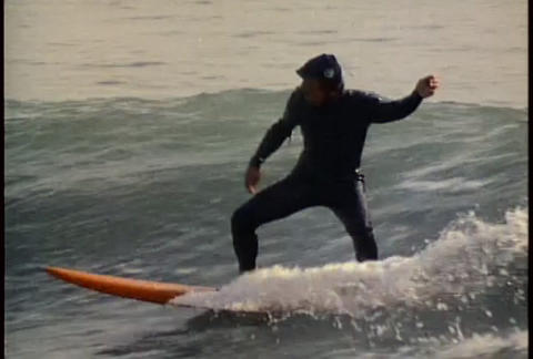 A surfer rides a wave Footage