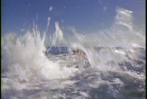 A man dives into the ocean and swims away Footage