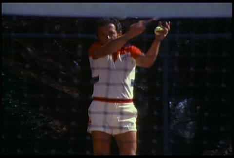 A man playing tennis through the net Stock Video Footage