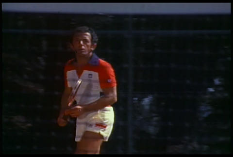 A man playing tennis through the net Footage