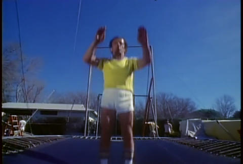 A retro man jumps on a trampoline Stock Video Footage