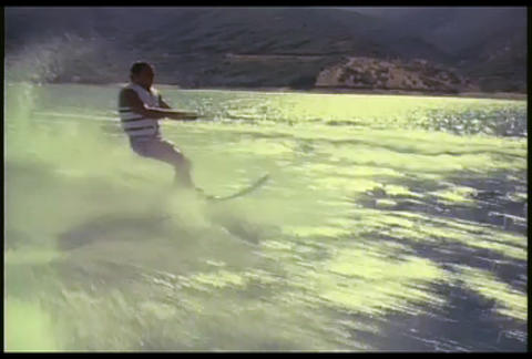 A man waterskis on a lake Stock Video Footage
