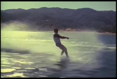 A man waterskis on a lake Footage