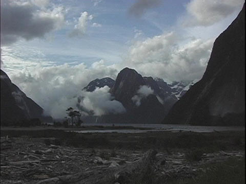 The camera zooms-out from a foggy fjord in New Zealand Stock Video Footage