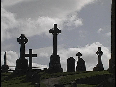 A United Kingdom hillside cemetery's markers stand... Stock Video Footage