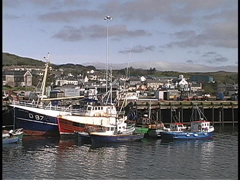 Ships and boats float in an Irish harbor Footage