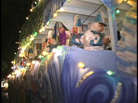 A large duck float glows with lights in a Mardi Gras Parade Stock Video Footage