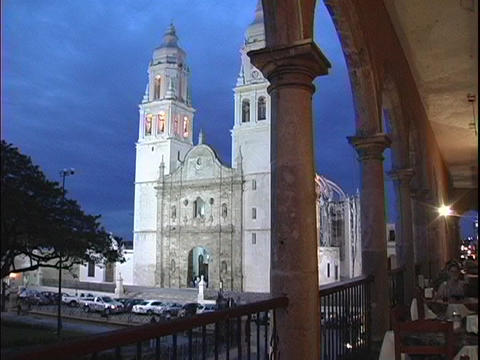A white Mexican cathedral adorns a violet night sky Footage