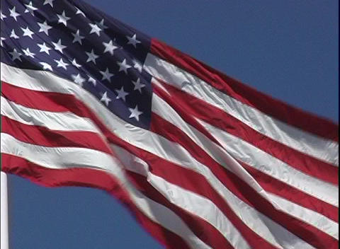 The American flag flows in the breeze Stock Video Footage