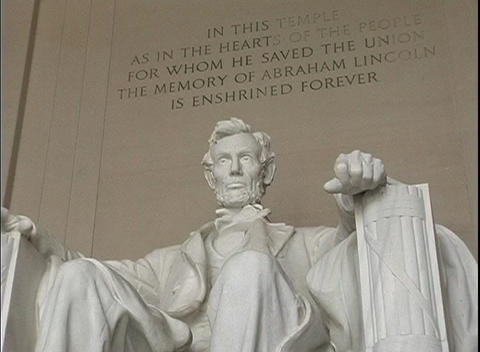 The seated sculpture of Abraham Lincoln marks the Lincoln Memorial Monument in Washington, DC Footage